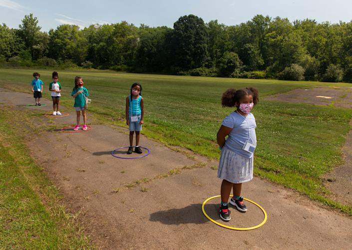 Children line up for school at Wesley Elementary in Middle­town, Conn., on July 20 | Gillian Laub for TIME