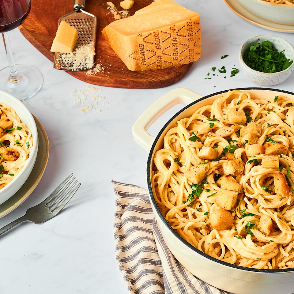 """<p>This spaghetti recipe is simple to make and combines creamy, delicate <a href=""""https://www.granapadano.it/en-ww/default.aspx"""" rel=""""nofollow noopener"""" target=""""_blank"""" data-ylk=""""slk:Grana Padano"""" class=""""link rapid-noclick-resp"""">Grana Padano</a> cheese with smoked garlic that gives a lovely barbecue flavour. It's made to be served in big bowls with toasted garlic bread croutons scattered on top.</p><p>Get the <a href=""""https://www.delish.com/uk/cooking/recipes/a36149939/smoked-garlic-and-grana-padano-spaghetti-recipe/"""" rel=""""nofollow noopener"""" target=""""_blank"""" data-ylk=""""slk:Smoked Garlic And Grana Padano Spaghetti"""" class=""""link rapid-noclick-resp"""">Smoked Garlic And Grana Padano Spaghetti</a> recipe.</p>"""