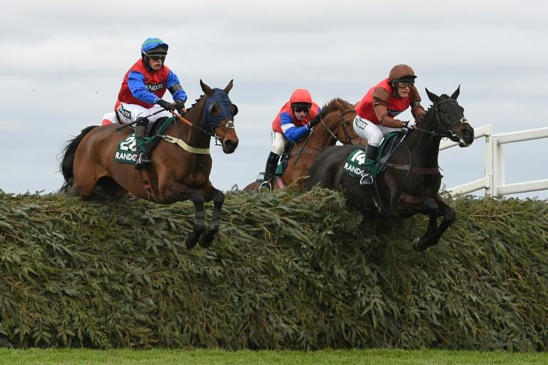 David Maxwell jumps The Chair on Mendip Express (R) during the Foxhunters' Open Hunters' Chase on the opening day of the Grand National Festival at Aintree Racecourse in Liverpool, northwest England, on April 6, 2017