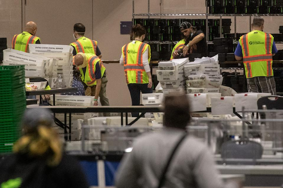 Election workers count ballots at the Philadelphia Convention Center on Nov. 6.