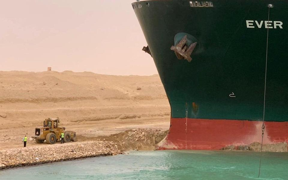 Part of the vessel, lodged sideways into the bank of the canal - MARINA PASSOS/Suez CANAL/AFP via Getty Images