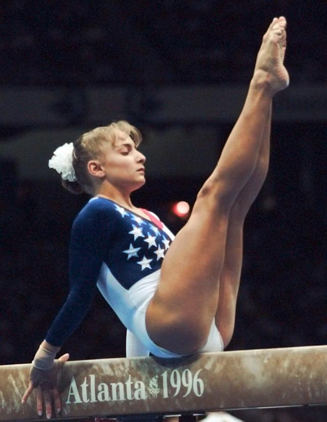 USA's Shannon Miller, of Edmond, Okla., practices on the balance beam Tuesday, July 16, 1996 in Atlanta's Georgia Dome. (AP Photo/John Gaps III)