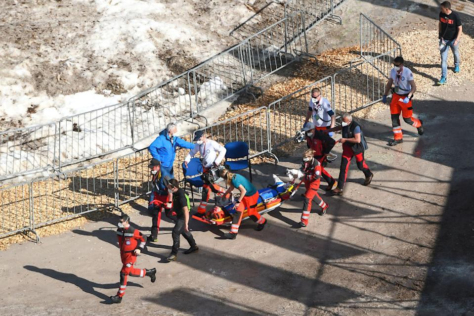 PLANICA, SLOVENIA - 2021/03/25: Medical staff provide assistance to Daniel Andre Tande of Norway after he crashes during the FIS Ski Jumping World Cup Flying Hill Individual competition in Planica. (Photo by Milos Vujinovic/SOPA Images/LightRocket via Getty Images)