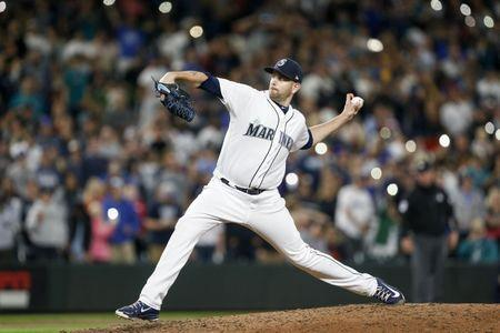 May 19, 2018; Seattle, WA, USA; Seattle Mariners starting pitcher James Paxton (65) throws against the Detroit Tigers during the ninth inning at Safeco Field. Mandatory Credit: Joe Nicholson-USA TODAY Sports