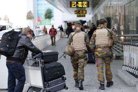 Belgian soldiers patrol at Zaventem international airport near Brussels, November 22, 2015, after security was tightened in Belgium following the fatal attacks in Paris. REUTERS/Francois Lenoir
