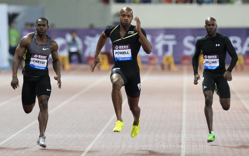 FILE - In this Saturday, May 19, 2013 file photo, Asafa Powell of Jamaica, center, competes with Nesta Carter of Jamaica, left, and Kim Collins of Saint Kitts, right, during the men's 100 meter at the Diamond League track and field competition in Shanghai, China. Former 100-meter world-record holder Asafa Powell and Jamaican teammate Sherone Simpson have each tested positive for banned stimulants, according to their agent. Paul Doyle told The Associated Press on Sunday, July 14, 2013 that they tested positive for the stimulant oxilofrine at the Jamaican championships and were just recently notified. The news came the same day that American 100-meter record holder Tyson Gay revealed that he also failed a drug test. (AP Photo/Eugene Hoshiko, File)