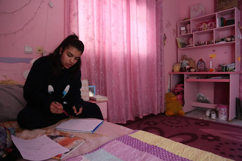 "Fatma Youssef, 17, a Palestinian high school student and a horse rider, studies for school in her room in her family house in Gaza City, Feb. 7, 2019. ""I'm nervous because this is my final high school year, but when I ride my horse I become free of stress,"" Youssef said. (Photo: Samar Abo Elouf/Reuters)"