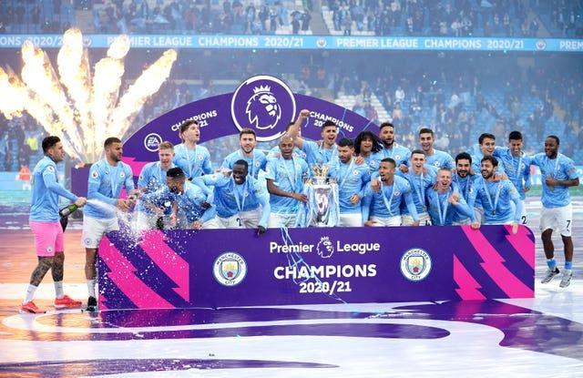 Manchester City players celebrate with the trophy