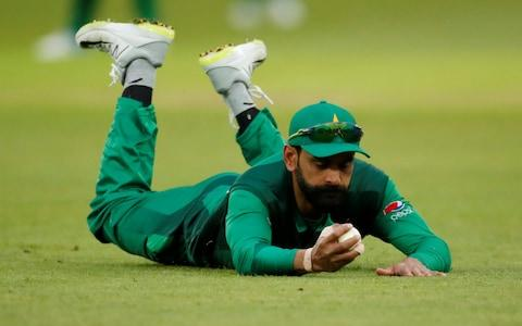 <span>Hafeez sparks England's fightback by clinging on to a difficult chance to dismiss Joe Root</span> <span>Credit: Action Images via Reuters/Andrew Boyers </span>