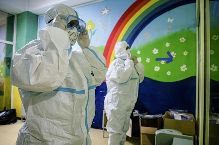 Doctors check their personal protective equipment before entering the ICU to treat patients infected with COVID-19 at Saint Petros Hospital in Addis Ababa, Ethiopia on July 17, 2020 (AFP Photo/Amanuel Sileshi)