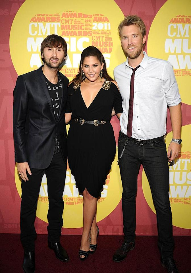 """Musicians Dave Haywood, Hillary Scott, and Charles Kelley -- of Lady Antebellum -- posed for a cute pic before heading into Nashville's Bridgestone Arena. Do you like Hillary's look? We don't think that belt is doing her any favors. Rick Diamond/<a href=""""http://www.gettyimages.com/"""" target=""""new"""">GettyImages.com</a> - June 8, 2011"""