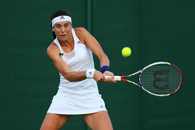LONDON, ENGLAND - JUNE 26: Sorana Cirstea of Romania plays a backhand during her Ladies' Singles second round match against Camila Giorgi of Italy on day three of the Wimbledon Lawn Tennis Championships at the All England Lawn Tennis and Croquet Club on June 26, 2013 in London, England. (Photo by Julian Finney/Getty Images)