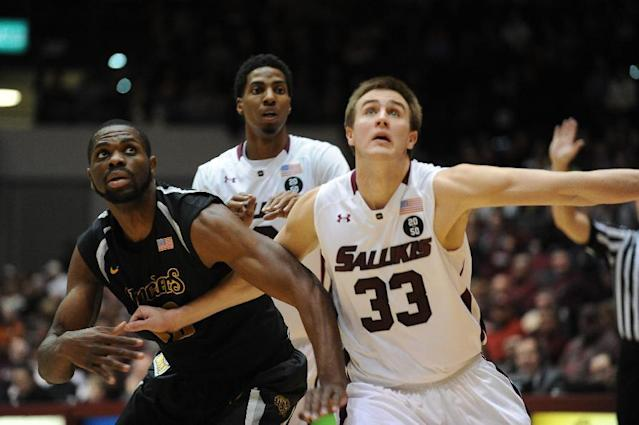 Southern Illinois Sean O'Brien, right, blocks out Wichita State's Kadeem Coleby 20, during the first period of a Missouri Valley Conference NCAA college basketball game in Carbondale, Ill., Thursday, Jan. 2, 2014. (AP Photo/Stephen Lance Dennee)