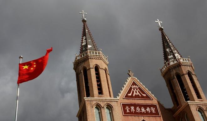 A Chinese flag flies in front of a Catholic church in northern Hebei province. Details of the bishops deal have never been made public. Photo: Reuters
