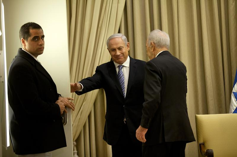 Israeli Prime Minister Benjamin Netanyahu, center, and Israeli President Simon Peres leave after a brief ceremony in the president's residence, on Saturday, March 2, 2013 in Jerusalem, Israel. (AP Photo/Uriel Sinai, Pool)