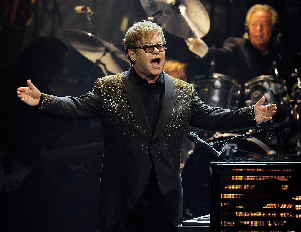 "Since he arrived on the American music scene in 1970, ""Rocket Man"" Elton John has had a string of hits including ""Your Song,"" ""Benny and the Jets,"" and the best-selling single of all time, ""Candle in the Wind."" Eventually, John became one of the Recording Industry Association of America's most successful artists of the century, a list that also include Brits such as The Beatles, and home-grown acts like Elvis Presley and Garth Brooks. He continues to perform, but these days the singer is just as famous for his work with the Elton John AIDS Foundation he founded in 1992. Sir Elton was even knighted by Queen Elizabeth II for his charity work in 1998."