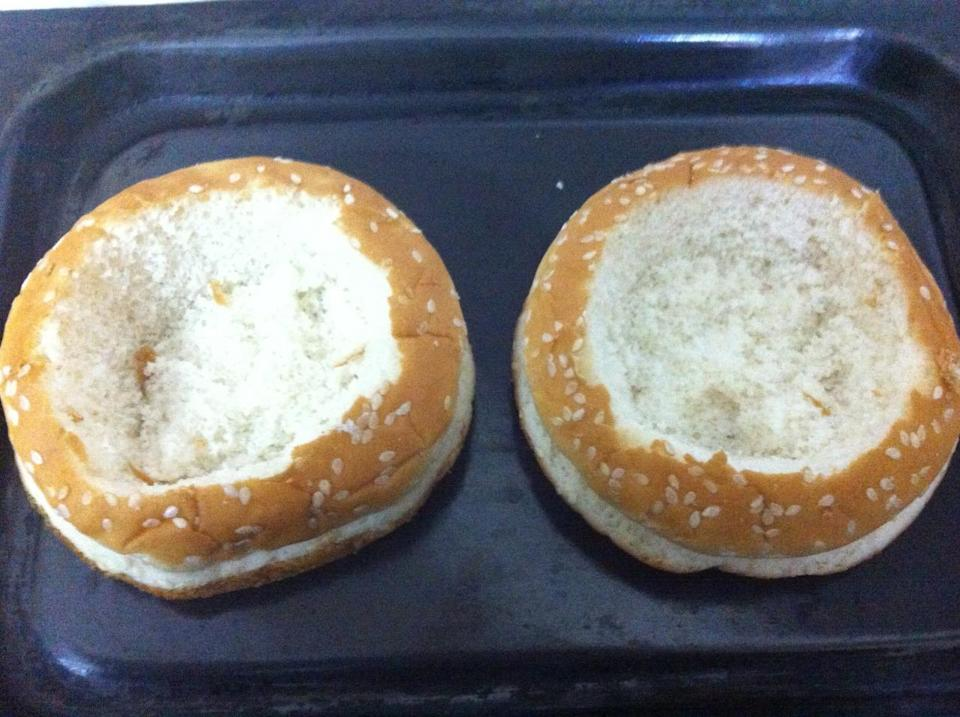 "<p>Scoop out the center of your buns to lessen the empty carbs you're eating. <i>(<a href=""https://gastronomicallyurs.files.wordpress.com/2014/02/photo-1.jpg"" rel=""nofollow noopener"" target=""_blank"" data-ylk=""slk:Photo Credit"" class=""link rapid-noclick-resp"">Photo Credit</a>)</i></p>"