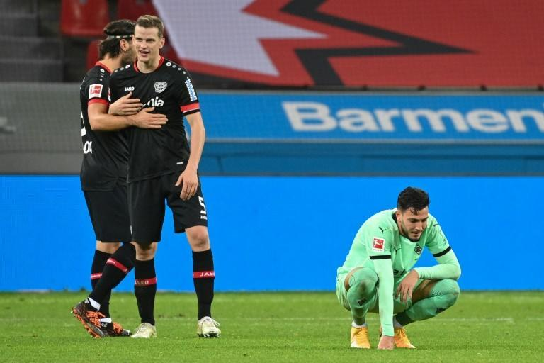 Algerian Ramy Bensebaini (R) shows his disappointment after Borussia Moenchengladbach lost to Bayer Leverkusen