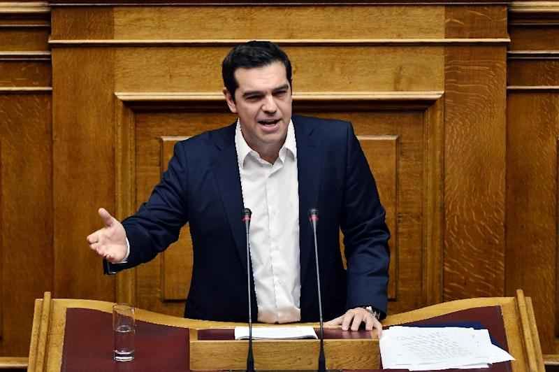 Greek Prime Minister Alexis Tsipras gestures as he addresses lawmakers at the Greek Parliament in Athens on October 5, 2015 (AFP Photo/Louisa Gouliamaki)