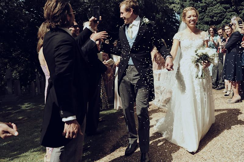 I loved this moment, we were showered with confetti as we walked down to the car.