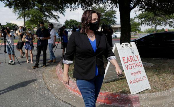 PHOTO: Democratic U.S. Senate candidate MJ Hegar heads to an early polling site after talking with the media, July 9, 2020, in Austin, Texas. (Eric Gay/AP)