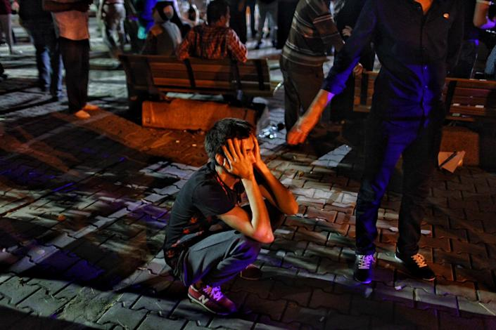 <p>A relative of the Ataturk Airport suicide bomb attack victim wait dejectedly outside Bakirkoy Sadi Konuk Hospital, in the early hours of June 29, 2016 in Istanbul, Turkey. (Defne Karadeniz/Getty Images) </p>