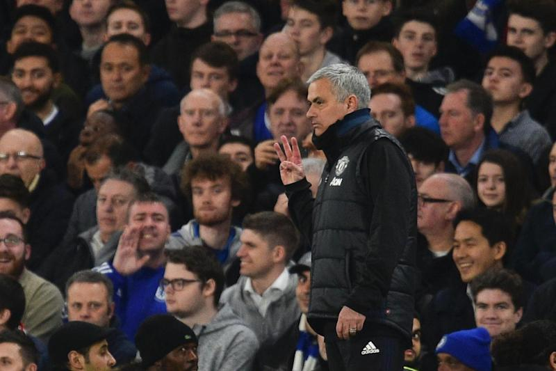 Three titles: Jose Mourinho gestures to Chelsea fans during defeat at Stamford Bridge earlier this season (AFP/Getty Images)