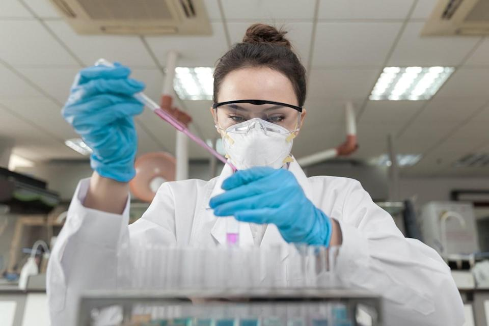 Scientist working in a laboratory using a pipette