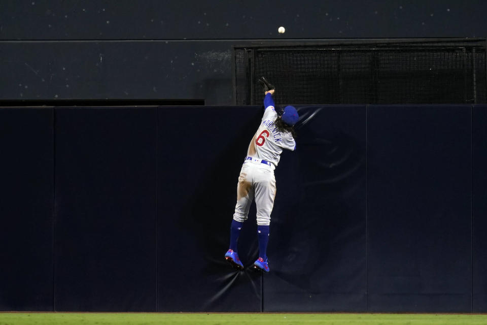 Chicago Cubs center fielder Jake Marisnick cannot reach a two-run home run by San Diego Padres' Brian O'Grady during the third inning of a baseball game Monday, June 7, 2021, in San Diego. (AP Photo/Gregory Bull)