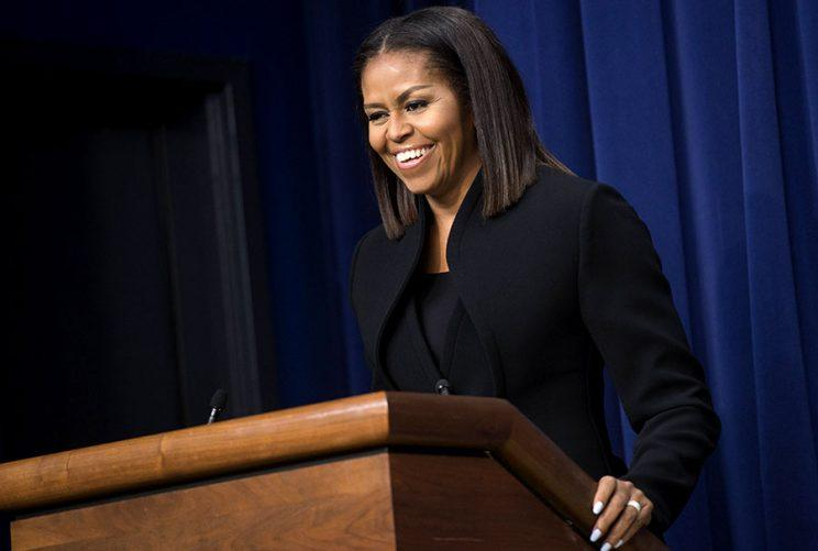 Michelle Obama flashes a smile at the White house screening of