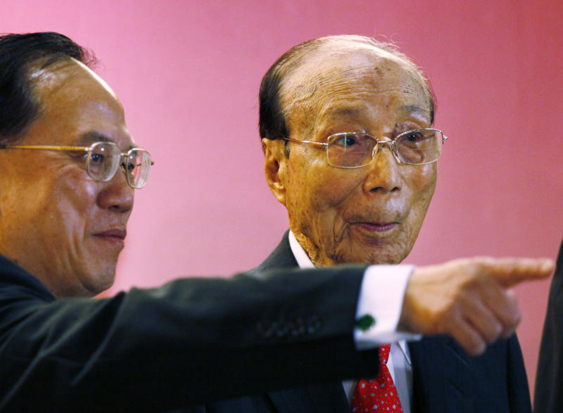 In this Tuesday, Sept, 28, 2010 photo, Hong Kong movie producer Run Run Shaw, right, poses with Hong Kong Chief Executive Donald Tsang during the Run Run Shaw prize presentation ceremony in Hong Kong. Pioneering Hong Kong movie producer Run Run Shaw has died at the age of 107. No cause of death was given in a statement from Television Broadcasts Limited (TVB), which Shaw helped found in 1967. (AP Photo/Kin Cheung)