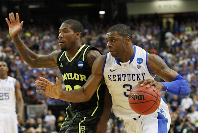 ATLANTA, GA - MARCH 25: Terrence Jones #3 of the Kentucky Wildcats drives against A.J. Walton #22 of the Baylor Bears in the second half during the 2012 NCAA Men's Basketball South Regional Final at the Georgia Dome on March 25, 2012 in Atlanta, Georgia. (Photo by Kevin C. Cox/Getty Images)