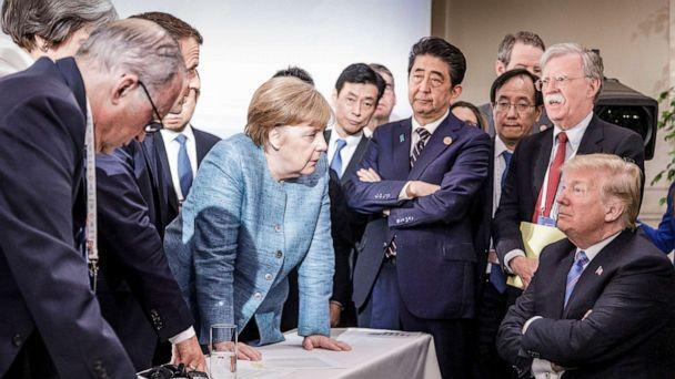 PHOTO: German Chancellor Angela Merkel speaks with President Donald Trump on the sidelines of the official agenda of the G7 summit on June 9, 2018, in Charlevoix, Canada. (Handout/Getty Images, FILE )
