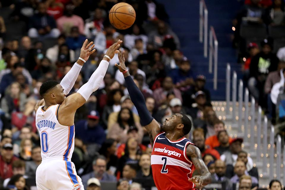Russell Westbrook of the Oklahoma City Thunder shoots over John Wall of the Washington Wizards during the second half at Capital One Arena.