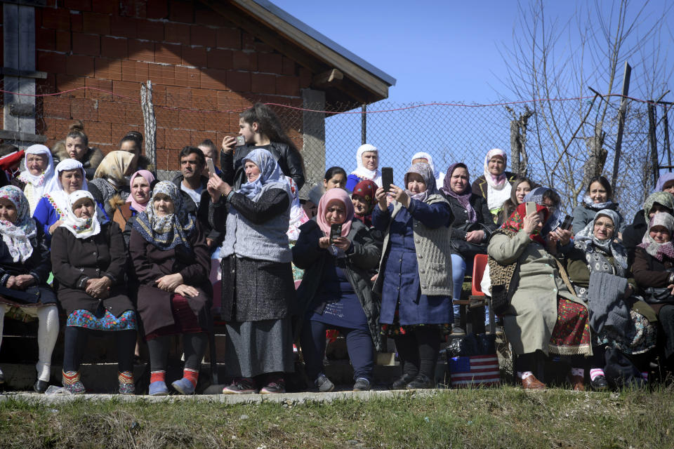 Bulgarian muslims use their mobile phones to make photos during mass circumcision ceremony in the village of Ribnovo, Bulgaria, Sunday, April 11, 2021. Despite the dangers associated with COVID-19 and government calls to avoid large gatherings, Hundreds of people flocked to the tiny village of Ribnovo in southwestern Bulgaria for a four-day festival of feasting, music and the ritual of circumcision which is considered by Muslims a religious duty and essential part of a man's identity. (AP Photo/Jordan Simeonov)