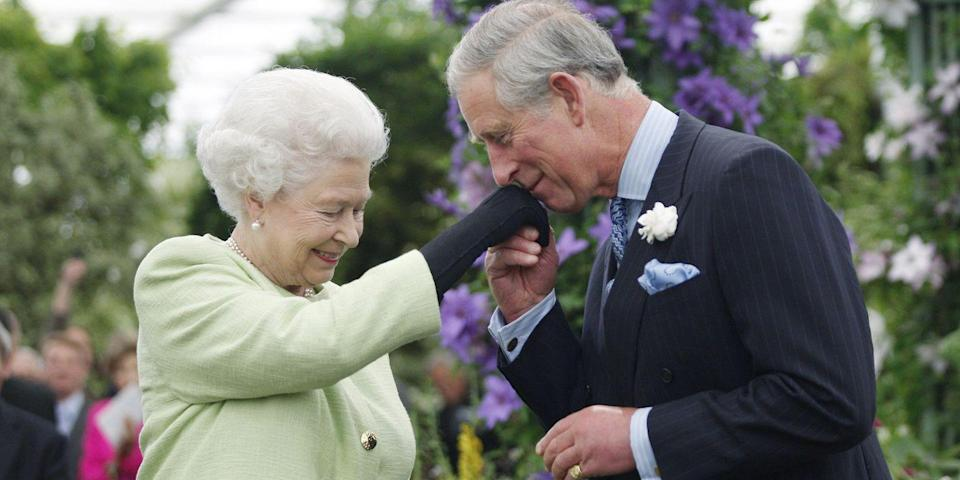 <p>Kissing his mother's hand after she presents him with the Royal Horticultural Society's Victoria Medal of Honour at the Chelsea Flower Show in London. </p>