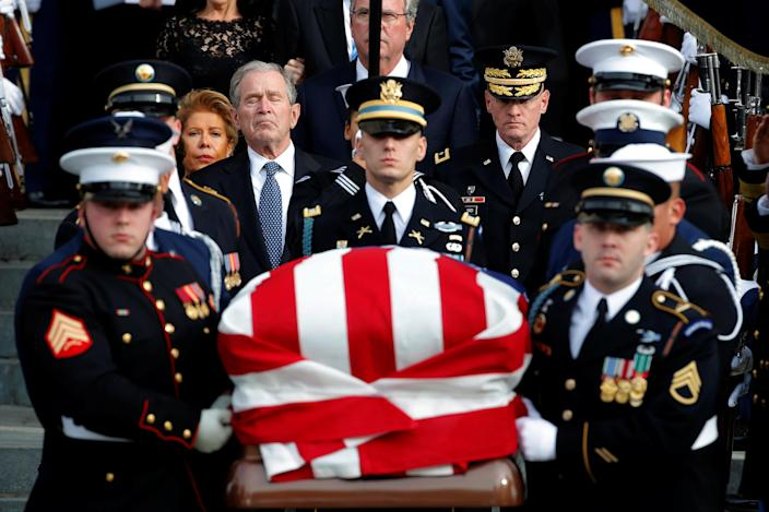 Former President George W. Bush follows a military honor guard as they carry the casket out of a state funeral for U.S. President George H.W. Bush at the Washington National Cathedral in Washington, Dec. 5, 2018. (Photo: Jonathan Ernst/Reuters)