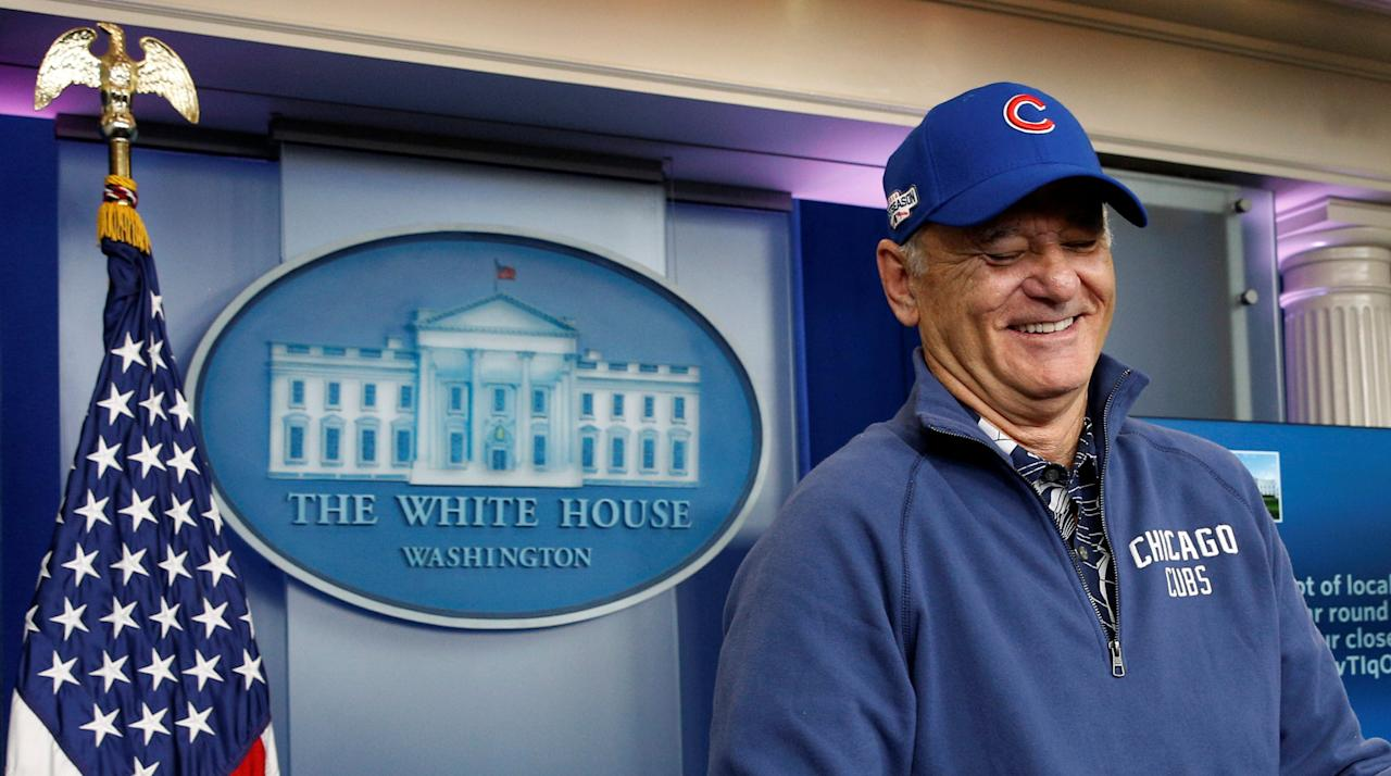 Actor Bill Murray, in Chicago Cubs attire, laughs during a visit to the White House briefing room in Washington October 21, 2016. REUTERS/Kevin Lamarque