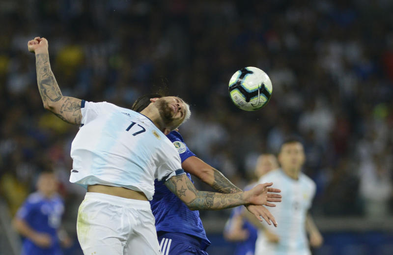 Argentina's Nicolas Otamendi heads the ball during a Copa America Group B soccer match at the Mineirao stadium in Belo Horizonte, Brazil, Wednesday, June 19, 2019. (AP Photo/Eugenio Savio)