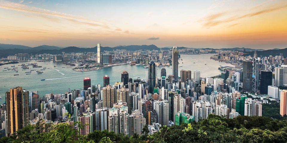 """<p>There are few skylines in the world that can compete with Hong Kong's. Not only does it have dozens of skyscrapers — dazzlingly lit up at night — but they're framed by <a href=""""https://www.tripadvisor.com/Attraction_Review-g294217-d593054-Reviews-Victoria_Harbour-Hong_Kong.html"""" rel=""""nofollow noopener"""" target=""""_blank"""" data-ylk=""""slk:Victoria Harbour"""" class=""""link rapid-noclick-resp"""">Victoria Harbour</a>, which is teeming with yachts, Star Line ferries, and traditional junk boats. To get a bird's-eye view of this unforgettable scene, stake out a prime spot in a rooftop bar in one of HK's high-rise hotels.</p>"""