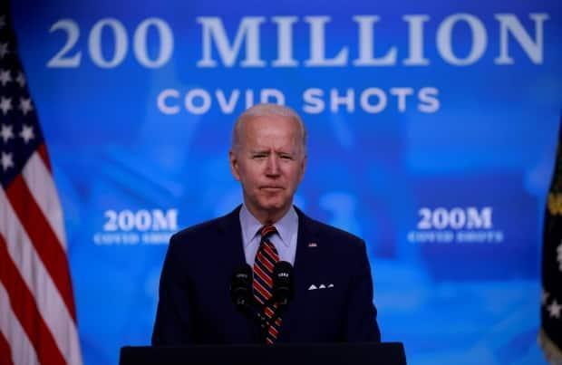 U.S. President Joe Biden says 200 million COVID-19 vaccine doses have now been administered in the U.S., double his original target for his first 100 days. (Tom Brenner/Reuters - image credit)