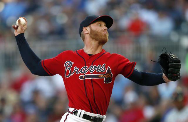FILE - In this May 31, 2019, file photo, Atlanta Braves starting pitcher Mike Foltynewicz works against the Detroit Tigers in the first inning of a baseball game, in Atlanta. The Atlanta Braves have recalled right-hander Mike Foltynewicz from Triple-A Gwinnett to take a spot in the starting rotation after Kevin Gausman was claimed off waivers by the Cincinnati Reds. (AP Photo/John Bazemore, File)