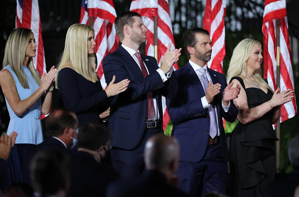 WASHINGTON, DC - AUGUST 27:  (L-R) Lara Trump, Ivanka Trump, Eric Trump, Donald Trump Jr. and Tiffany Trump cheer and applaud as U.S. President Donald Trump delivers his acceptance speech for the Republican presidential nomination on the South Lawn of the White House August 27, 2020 in Washington, DC. Trump gave the speech in front of 1500 invited guests.  (Photo by Chip Somodevilla/Getty Images)