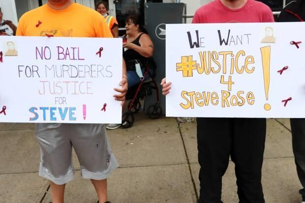 Friends and supporters of murder victim Stephen Rose attended a protest outside the Sydney Justice Centre on Tuesday.  (Erin Pottie/CBC - image credit)