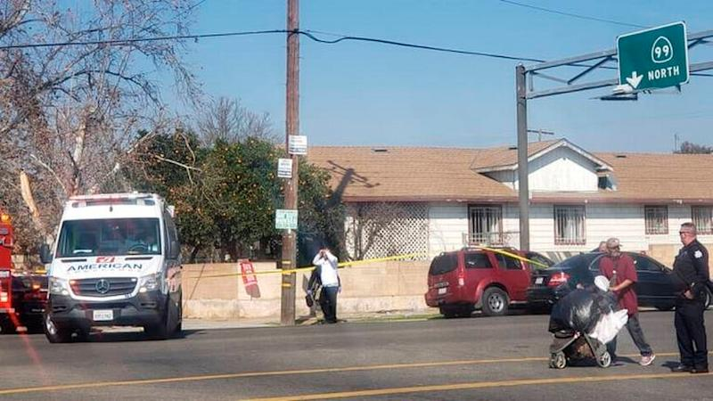 In this Saturday, Feb. 1, 2020 image from video, Fresno Police investigate a shooting in Fresno, Calif. Police say an argument about the Super Bowl led up to the shooting. A man shot during an argument over the Super Bowl has died in central California.