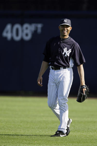 New York Yankees' Mariano Rivera laughs during a workout at baseball spring training, Saturday, Feb. 16, 2013, in Tampa, Fla. (AP Photo/Matt Slocum)