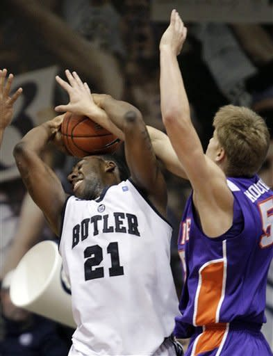 Butler forward Roosevelt Jones, left, gets fouled by Evansville guard Troy Taylor during the second half of an NCAA college basketball game, Saturday, Dec. 22, 2012, in Indianapolis. Butler won 75-67. (AP Photo/AJ Mast)