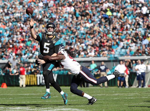 Jadaveon Clowney hits Blake Bortles during the Jacksonville Jaguars' 45-7 win over the Houston Texans. (Getty Images)