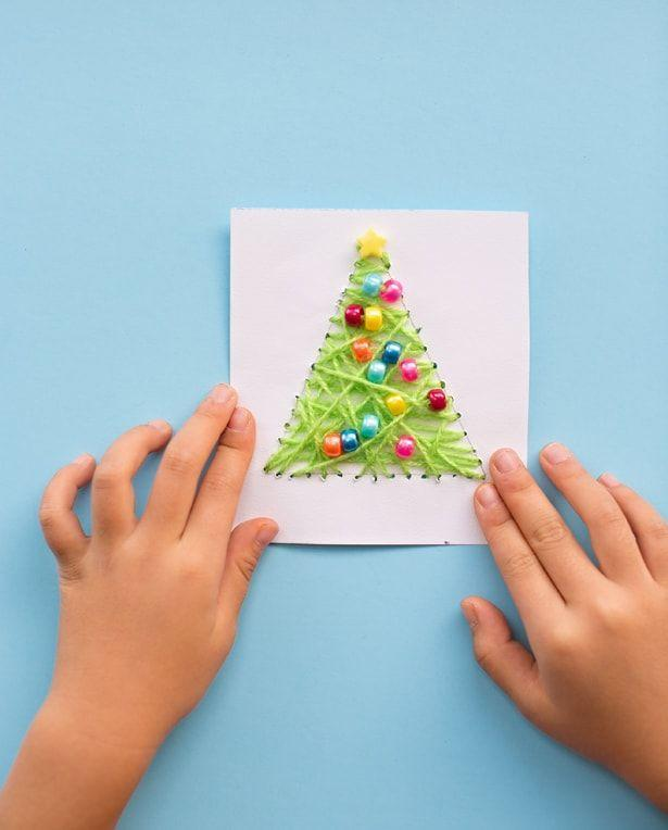"""<p>Got some yarn scraps lying around? Turn them into DIY Christmas cards with a few quick steps, and prepare to impress all your friends. </p><p><strong>Get the tutorial at <a href=""""https://www.hellowonderful.co/post/KID-MADE-DIY-STRING-ART-CHRISTMAS-CARDS/"""" rel=""""nofollow noopener"""" target=""""_blank"""" data-ylk=""""slk:Hello, Wonderful"""" class=""""link rapid-noclick-resp"""">Hello, Wonderful</a>.</strong></p><p><strong><a class=""""link rapid-noclick-resp"""" href=""""https://www.amazon.com/Pony-Beads-Multi-Color-1000/dp/B004D9DMMW?tag=syn-yahoo-20&ascsubtag=%5Bartid%7C10050.g.3872%5Bsrc%7Cyahoo-us"""" rel=""""nofollow noopener"""" target=""""_blank"""" data-ylk=""""slk:SHOP PONY BEADS"""">SHOP PONY BEADS</a><br></strong></p>"""