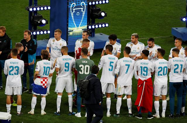 Soccer Football - Champions League Final - Real Madrid v Liverpool - NSC Olympic Stadium, Kiev, Ukraine - May 26, 2018 Liverpool's Jordan Henderson is dejected as he walks past Real Madrid players after losing the Champions League final REUTERS/Phil Noble